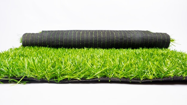 Roll of artificial green grass isolated on white background, lawn.