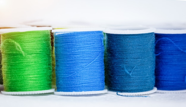 The roll of colorful thread on background,show texture of thread