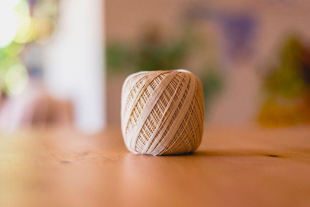 Roll of cotton yarn on a table.