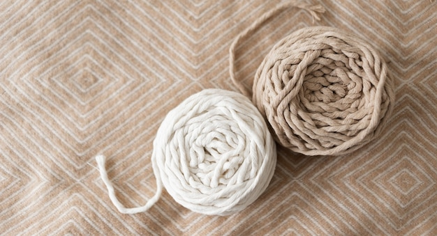 Roll of macrame rope. white and gray thread on a beautiful pastel background
