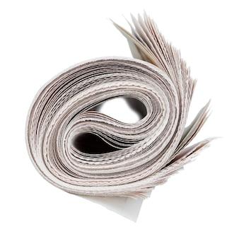 新聞のロール。白で隔離。ニュースとアップデートのコンセプト。