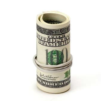 Roll of one hundred dollar bills tied in burlap string isolated.