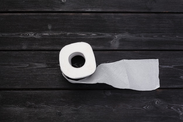 Roll of paper towel on wooden