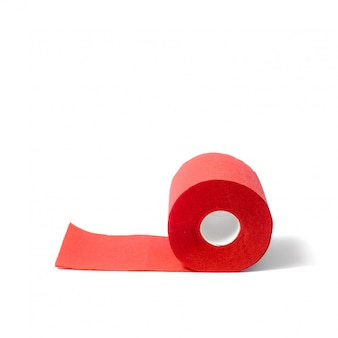 Roll of red coral toilet paper isolated on white