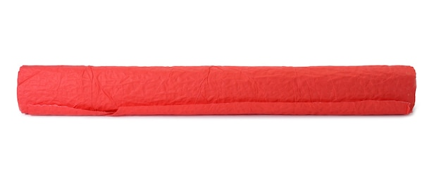 Roll of red crumpled paper for gift wrapping isolated on white background