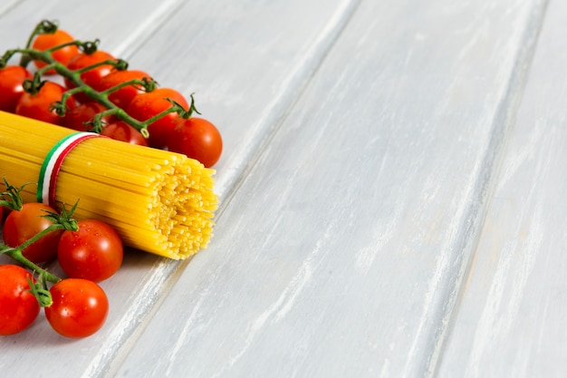 Roll of spaghetti with cherry tomatoes