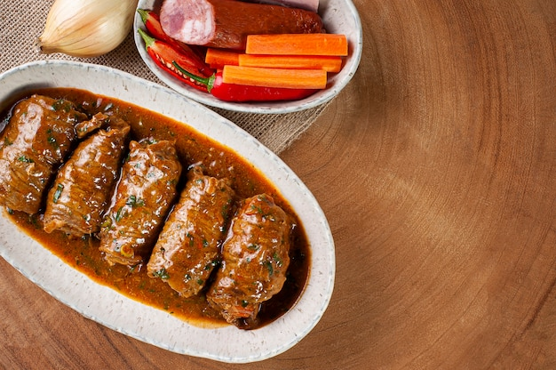 Roll steak in delicious tomato sauce. top view. copy space
