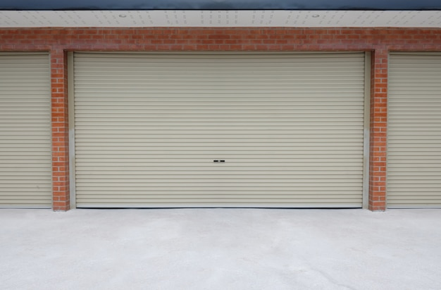 Roll steel door or shutter door and concrete floor outside building of home car parking.