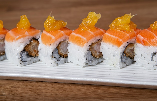 Roll sushi with battered salmon and prawn. sushi menu. japanese food