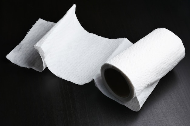 Roll of tissue paper on black background
