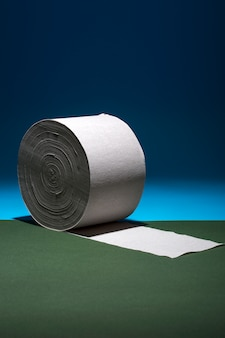 Roll of toilet paper on a colored