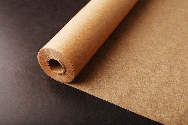 Roll of unfolded brown parchment paper for baking food