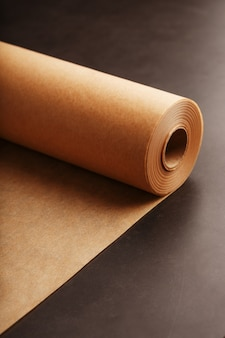 A roll of unfolded brown parchment paper, for baking food
