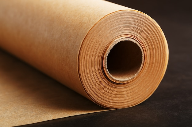 A roll of unfolded brown parchment paper