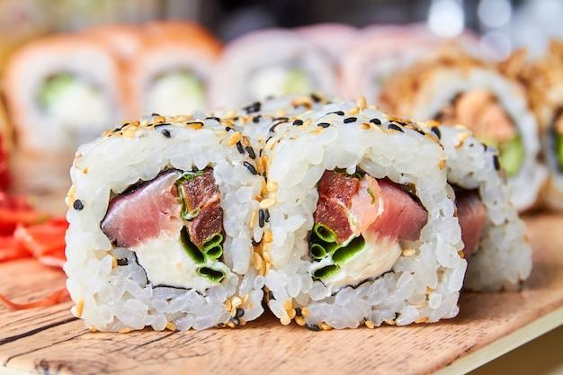 Roll with cream cheese, tuna, sesame tomato and green onions