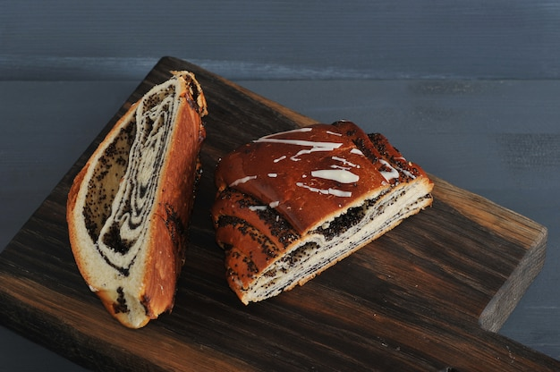 Roll with poppy seeds, cut in half on wooden