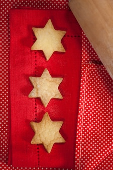 Roll with star-shaped cookies on a wooden table