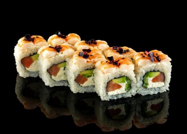 Roll with tuna, shrimp and avocado.