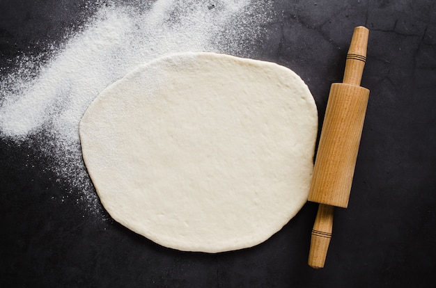 Rolled dough, baking flour and rolling pin