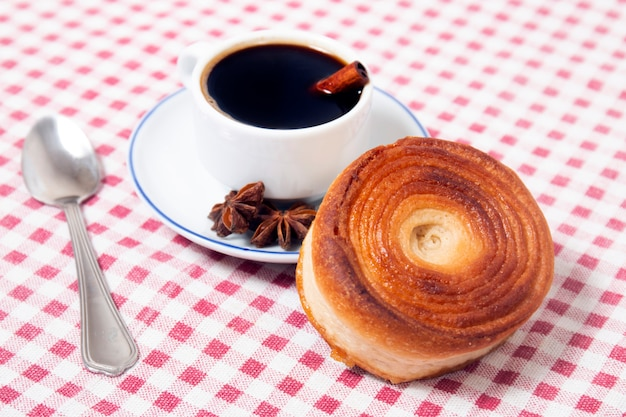 Rolled honey pastries with coffee