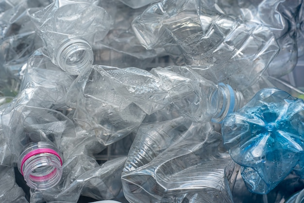 Rolled plastic bottles for recycling.