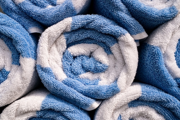 Rolled up of blue and white spa or pool towels.