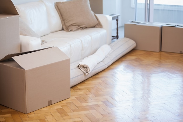 Rolled up carpet and boxes