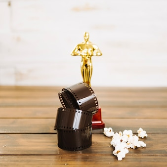 Rolled up film, popcorn and oscar statuette