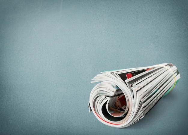 Rolled up  newspapers close up on  background