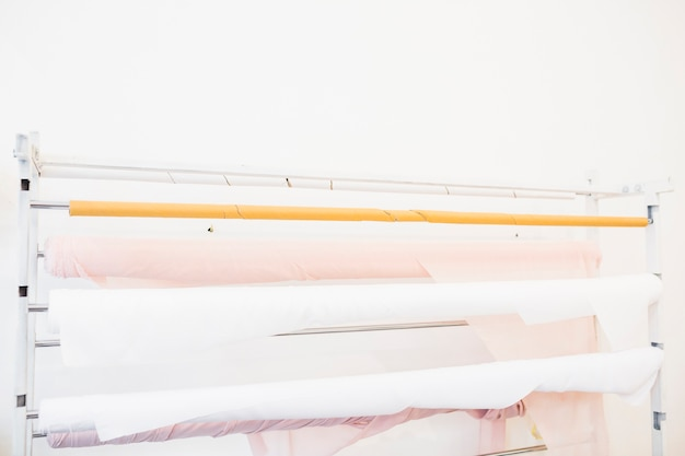 Rolled up pink and white fabrics in tailor shop
