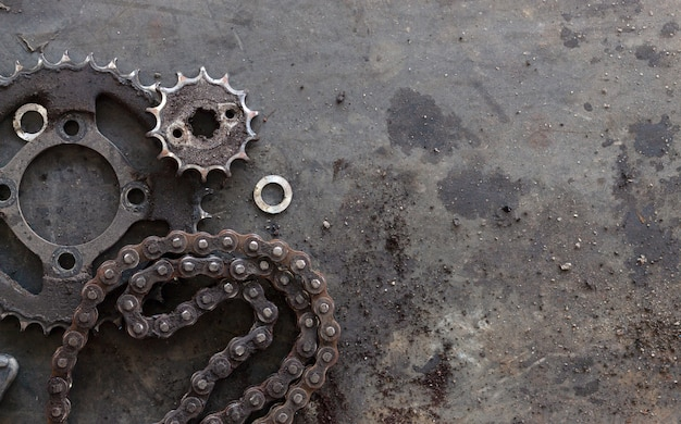 Roller chains with sprockets for motorcycles on old black  background. top view
