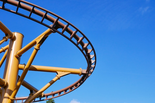Roller coaster in the blue sky