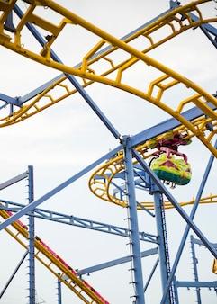 Roller coaster ride against sky