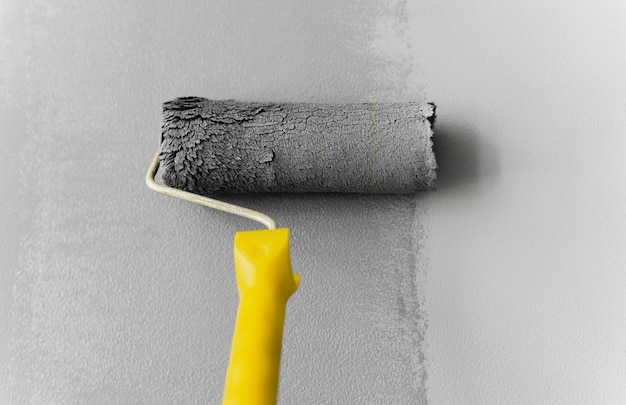 Roller painting wall gray color