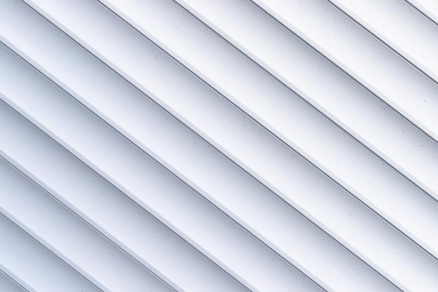 ローラーシャッターのテクスチャ。白の金属ストライプの背景