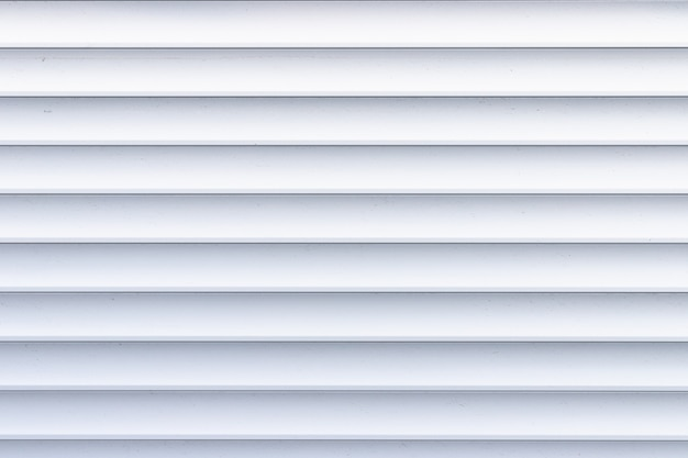 Roller shutter texture. background with metal stripes in white.