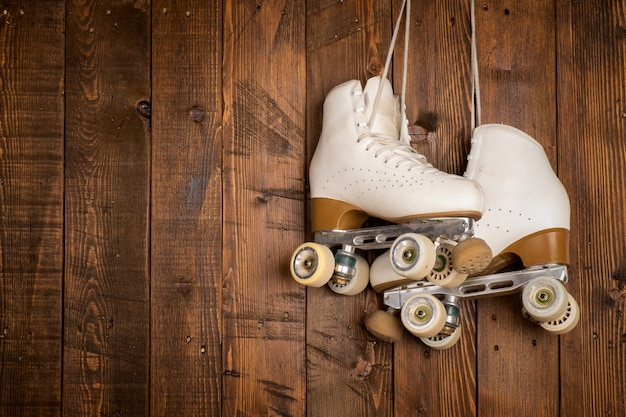 Roller skates on a wood