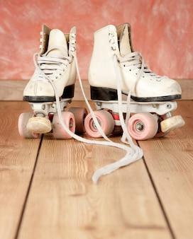 Roller skates on a wooden floor