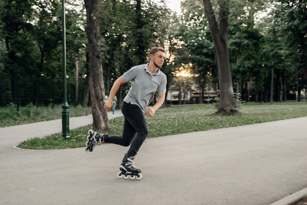 Roller skating, male skater rolling in action. urban roller-skating, active extreme sport outdoors, youth leisure, rollerskating