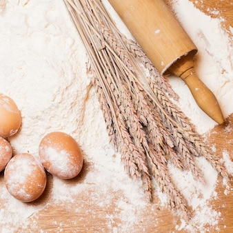 Rolling pin and eggs in the flour