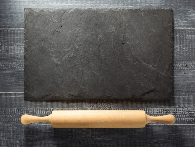 Rolling pin on wooden background texture