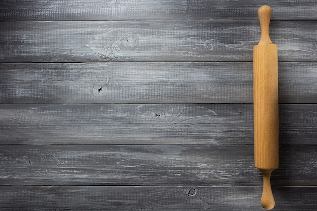 Rolling pin on wooden background