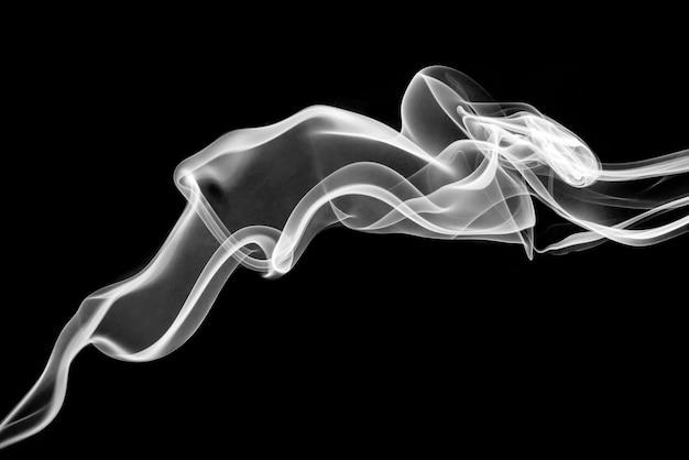 Rolling white smoke on black background