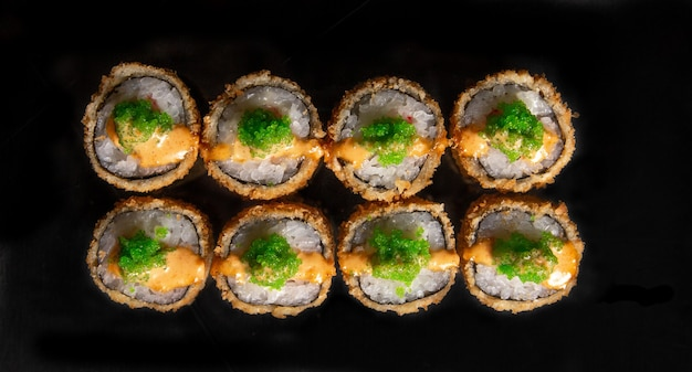 Rolls isolated on black background. photo for the menu.