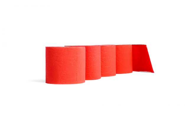 Rolls of red coral toilet paper isolated on white