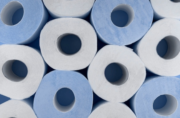 Rolls of white and blue toilet paper. shortage of toilet paper.