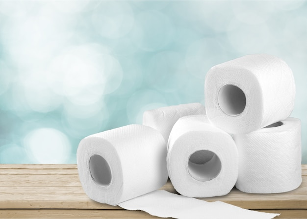Rolls of white toilet paper on table