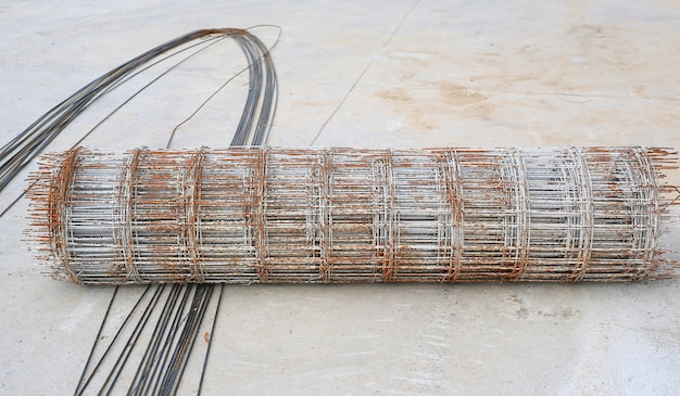 Rolls of wire mesh steel reinforced rod for concrete construction.
