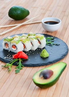 Rolls with avocado on a bamboo background.