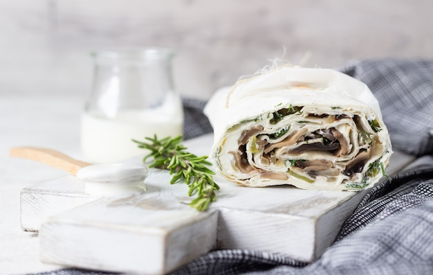 Rolls with cream and rosemary.